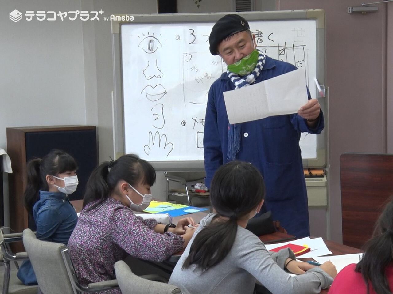 作文教室先生インタビュー風景WM